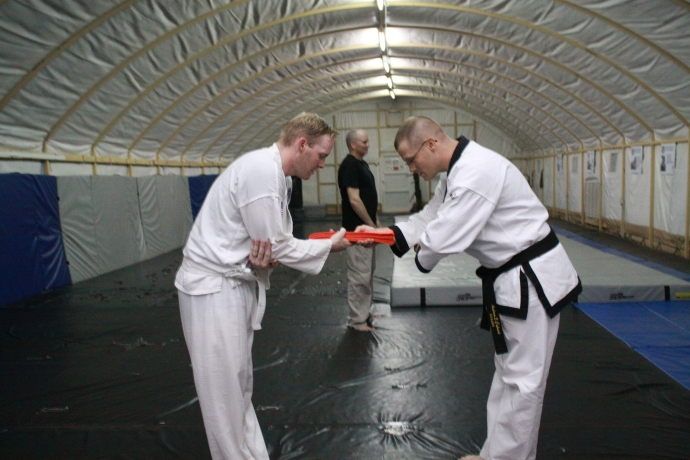 Mr. Jackson receiving his Orange Belt